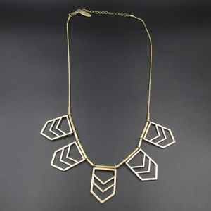 Gold Tone 23 Inch Plunder Brand Symbol Necklace